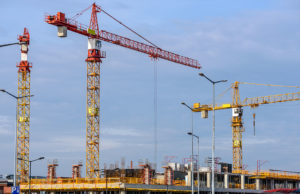 Various Construction Cranes Operating